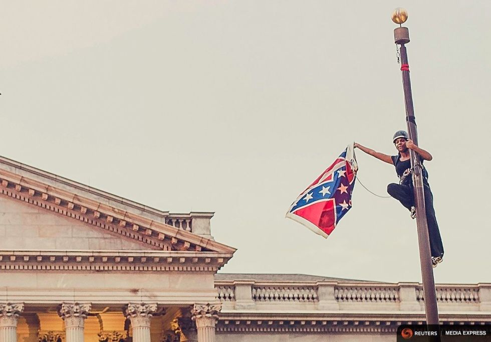 Heroine Bree Newsome, climbed on a post and took the Confederate Flag down.